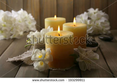 stock-photo-beautiful-candles-with-flowers-on-wooden-background-193299911